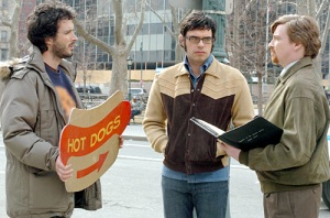 Flight of the Conchords having band meeting with road sign